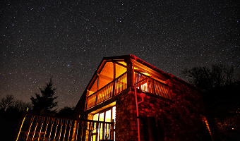 Dan Castell Holiday Cottage at night with stars
