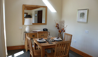 Dining area of Dan Castell Holiday Cottage