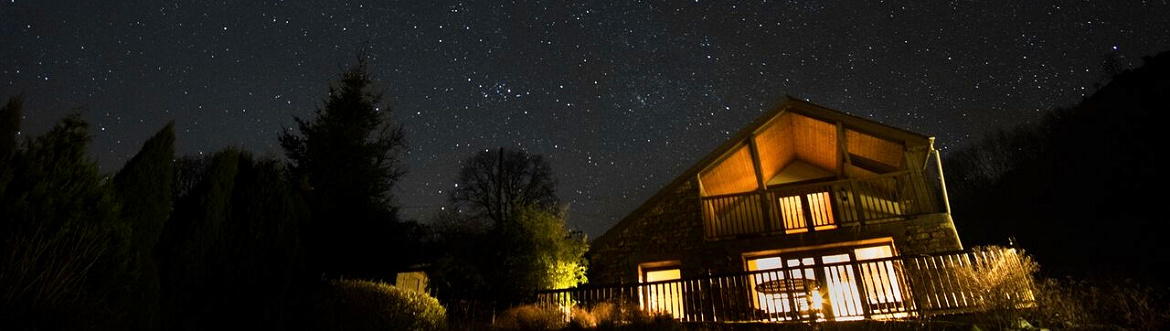 Dan Castell Holiday Cottage at night in the stars
